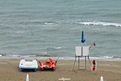 nessuno in giro (archgionni) Tags: sea sand beach barche boats onde waves ombrellone umbrellas bandiere flags nessuno nobody