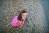 Pebble beach (mravcolev) Tags: child portrait girl daughter summer sea beach pebbles canoneos5dmarkii 5dmkii 35l canonef35mmf14lusm