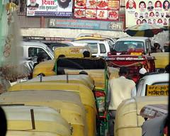 delhi yellow traffic (kexi) Tags: delhi india asia crowded traffic rickshaws taxis yellow dense samsung wb690 february 2017 red text cars people street instantfave