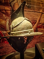 A relatively unadorned myrmillo style gladiator's helmet worn for practice or owned by a lower-ranking gladiator Pompeii Roman 1st century CE (mharrsch) Tags: helmet armor armour gladiator myrmillo roman pompeii 1stcenturyce ancient bronze omsi portland oregon mharrsch