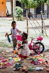 Toys Everywhere (SerCorzo) Tags: girls girl kid child portrait retrato toys doll dolls bike fun smile happy laugh playing rural outdoors light morning