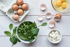 24/365: Brunch (judi may) Tags: 365the2018edition 3652018 day24365 24jan18 brunch food foodstyling flatlay eggs spinach feta fetacheese bowls dishes eggbox greens glass glassbowl wood canon7d 35mm