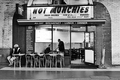 Hot Munchies (Douguerreotype) Tags: candid london people monochrome blackandwhite food uk british street city britain urban gb bw cafe england