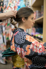British woman in kimono setting up hair (Apricot Cafe) Tags: img77642 asia canonef50mmf14usm caucasianethnicity healthylifestyle japan japaneseculture kimono newyear shibuyaward tokyojapan beautifulwoman brownhair candid carefree charming colorimage cultures formalwear grace hairset hairstyle happiness indoors lifestyles longhair makeup oneperson people photography sideview smiling tradition traditionalclothing traveldestinations waistup women youngadult shibuyaku tōkyōto jp