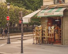 Esmeralda (ninasclicks) Tags: paris green esmeralda notre dame chairs cafe restaurant corner street travel travelphotography europe couple goldenlight
