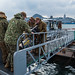 U.S. Navy Seabees move a water heater during a pile removal operation at Commander, Fleet Activities Sasebo