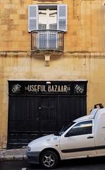 Useful Bazaar (Douguerreotype) Tags: balcony shop malta street buildings window city architecture valletta van urban store door