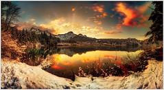 Wintry sunset (Karl Glinsner) Tags: landschaft landscape österreich austria berge gebirge mountains see lake winter schnee sonnenuntergang sunset wolken clouds snow almsee grünau almtal mountain water tree reflection