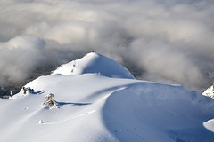 Snow above the fog (echumachenco) Tags: snow winter february light shadow balcony fog cloud inversionweather inversioncloud viewpoint outdoor top untersberg mountain salzburg austria österreich alps berchtesgadeneralpen landscape pine bush footprint