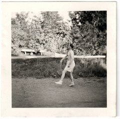 Ministry of silly Walks - or Tennis (Fremdwortlexikon) Tags: blackandwhite schwarzweis bw monochrome outside tree photoborder meadow man walking shirtless topless