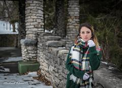 Cecelia in Winter 5 (makleen) Tags: watertown jeffersoncounty newyork model thompsonpark park gazebo stonegazebo overlook stone winter snow scarf sweater green cozy wall stonewall pinetree