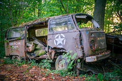 well-camouflaged (MGness / urbexery.com) Tags: lost place places abandoned abandone abandones exploration decay decayed car lostcar urbex urban urbexery rockandroll black death christine boyfriend urbanexploration rusty cargraveyard eye oldtimer wood forest wald nature vw bus volkswagen