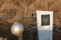 The Death Of The Man In The Bowler Hat (peterkelly) Tags: kyrgyzstan shabdan chonkeminvalley crescent moon orb rusty rust rusted death dead cemetery graveyard grave gravestone tombstone headstone hat bowlerhat fence