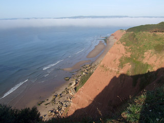 Cliff of High Land of Orcombe, Exmouth, with sea fog beyond