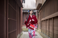 Young woman in kimono walking in traditional narrow street (Apricot Cafe) Tags: img26338 asia asianandindianethnicities ishikawaprefecture japan japaneseethnicity japaneseculture kanazawa kimono obisash sigma35mmf14dghsmart artscultureandentertainment buildingexterior charming cheerful citylife cultures day enjoyment fashion freedom freshness grace hairaccessory happiness lifestyles longhair narrow oldfashioned oneperson onlywomen outdoors photography relaxation smiling springtime straighthair street threequarterlength tourism tradition traditionalclothing tranquility travel traveldestinations walking weekendactivities women youngadult kanazawashi ishikawaken jp