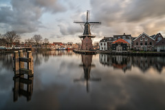 Hashtag Haarlem (reinaroundtheglobe) Tags: haarlem nederland thenetherlands netherlands dutch dutchlandscape noordholland holland molendeadriaan windmill traditionalwindmill spaarne river reflection waterreflections morning clouds