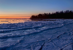 The Icy Shores of Lake Michigan (T P Mann Photography) Tags: seascape horizon sky silhouette reflections trees beach shores breezeway atwood michigan lake frozen cold ice water quiet still serenity color sundown sunset