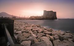 The city that wakes up. (Emykla) Tags: mare sea castello castle napoli campania italia italy nikon d3100 rocks sunrise alba