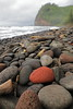 Red Rock on Beach in Hawaii (steveboer.com) Tags: red hawaii rock beach pebble shore water sea boulder outdoor seashore sky nature pile zen coast stone noperson landscape mountain ocean rocky travel group many outdoors summer white pololu valley