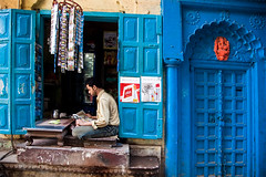 Blue shop (Dick Verton ( more than 12.000.000 visitors )) Tags: blue india man streetlife travel varanasi people sit sitting seated