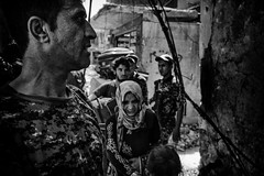 War in Mosul. Soldiers escorting a family out of the old city. (rvjak) Tags: mosul mossoul irak iraq middleeast moyenorient guerre war fight d750 nikon black white noir blanc bw