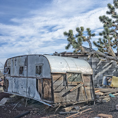 Camping Trailer (magnetic_red) Tags: trailer house building joshuatree outdoors decay junk abandoned mojavenationalpreserve