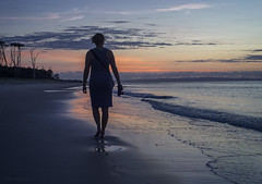 Foof at sunrise (gnarlydog) Tags: sunrise australia beach lowtide photographer lady barefoot walking silhoutte bluehour manualfocus zonlaidiscover25mmf18 reflection wet foreshore sea lowkey