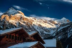 Gsteig (SLpixeLS) Tags: switzerland suisse mountain montagne alpes sky ciel chalet sunset coucherdesoleil gsteig gstaadt spitzhorn schluchhorn snow neige light lumière lune moon