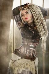 Hothouse Steampunk (jonron239) Tags: savra girl woman model steampunk curves figure bodystocking dreads skirt lace belt cartridges leather bra chains gunpowder necklace goggles