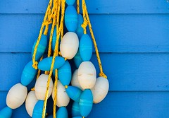Floats (Karen_Chappell) Tags: blue white float buoy rope fishing newfoundland nfld pettyharbour avalonpeninsula atlanticcanada shed yellow paint painted wood wooden clapboard rural building canada eastcoast buoyant yearend18