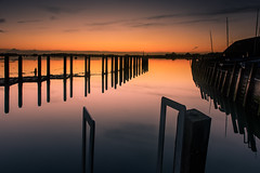 Stillness At The Quay (Sunset Snapper) Tags: stillnessatthequay sunset bosham westsussex southcoast uk reflections posts quay boathouse ladders afterglow still calm peaceful tranquil filter lee nd grad nikon d810 2470mm january 2018 sunsetsnapper