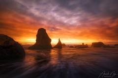 The Glow (Arwinder Nagi) Tags: oregon seascape water landscape sunset bandonbeach bandon coast ocean sea waves twilight scenic goldenhour clouds mist pacificnorthwest seastack reflections nature nagiphotography shootingnomads