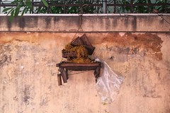 Offering, but different. (Ron van Zeeland) Tags: southeastasia asia religion buddhism shrines offering khmer cambodja cambodia phnompenh wall street city