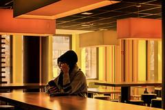 Social Contacts... (marionrosengarten) Tags: street colours yellow mcdonalds darmstadt stadt city stranger fremde muslim challenge 2018 yellows orange sun light bright sunnyday restaurant handy phone socialcontacts