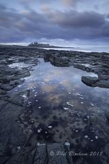 Dunstanburgh Castle 2 (Phil Bloxham) Tags: northumberland northsea rock reflections castle sea seascape ocean rockpool history zeissdistagont2821ze zeiss