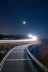 Night Walk (Pamaxteam) Tags: atlantic atlanticroad walk night ocean moon kaim pawelkaim pawelkaimphotography stars travel travelphotography light trails metal bridge starrynight