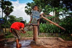 Smiling boy pumping water for his friend from a local well in rural Cambodia 👍 (Ib photography uk) Tags: travel travelling holiday traveling cambodia ruralcambodia asia ruralasia waterpump happy smile life world worldphotography journalism documentary travelphotography seetheworld makeadifference ibphotography buxz777 sony sonycameras sonycamera sonyimaging photography portrait portraitphotography naturallight a6000 sonyzeiss sonya6000 zeiss24mmf18