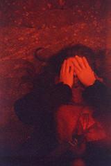 See No Evil (Magnus Bergström) Tags: lomography redscale xr lomographyredscalexr film 135 35mm luminox luminox356sl analog lomo steel girder portrait idanil00 karlstad alster värmland sweden sverige hair hands stone face cover red