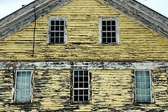 Gable in tattered yellow (DjD-567) Tags: abandoned roof gable windows dilapidated yellow farmhouse warner nh peelimg