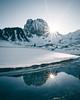 Double Trouble (noberson) Tags: switzerland mountain peak sunstar sun flare reflection snow winter nikon blue cold morning sunrise water