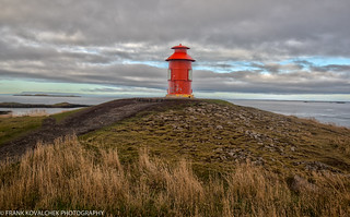 The lonely orange lighthouse at Stykkisholmur
