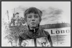 Apple Picking (jauza1) Tags: bw blackandwhite noireblanc person people kid child enfant children boy garcon little young