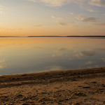 Warm susnset glow and reflections from the setting sun, Waskesiu Lake, Prince Albert National Park thumbnail