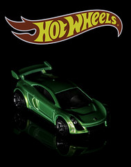 02469376262-97- Hot Wheels Mastretta MXR-1 (Jim There's things half in shadow and in light) Tags: canon5dmarkiv hotwheels logo mastrettamxr tamronsp90mmf28dimacro11vcusd car classiccar closeup flame green macro red reflection sports toy yellow