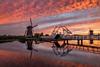 Dutch Inferno (Mario Visser) Tags: xt2 bridge fire fujifilm kinderdijk mariovisser nederland netherlands reflection sky sunset unesco water windmill