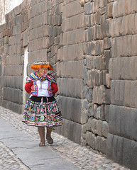 Walking through Cuzco (Lewitus) Tags: people ancientwall cuzco traditionalclothing hat peru