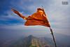 मराठा तितुका मेळवावा, महाराष्ट्र धर्म वाढवावा आहे तितुके जतन करावे, पुढे आणिक मेळवावे महाराष्ट्र राज्य करावे जिकडे तिकडे || (soumitra911) Tags: flag saffron maharashtra torna fort marathi pune india forts flags wind sky blur clouds mountain top shivaji maharaj culture heritage soumitra inamdar soumitra911