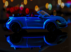 Blue Bug (Vanessa wuz here) Tags: toys macrotoys 90mm macro glow reflections shadows flickrlounge blue bokeh lighting macromadness