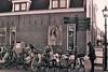 Dorpsstraat Bikes (Chemster) Tags: dorpsstraat street bikes black white bw netherlands signpost olympus om1 ilford