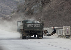 North Korean men repairing a smoking vapor truck on a highway, Kangwon Province, Wonsan, North Korea (Eric Lafforgue) Tags: army asia broken communism day dictatorship dprk engine fixing fulllength highway horizontal humanbeing kangwonprovince koreanscript lorry majorroad man men menonly motorway nkorea7418 northkorea northkorean oneperson outdoors people repairing road smoke smoking steamtruck steaming tarmac transportation truck urbanroad wonsan 北朝鮮 북한 朝鮮民主主義人民共和国 조선 coreadelnorte coréedunord coréiadonorte coreiadonorte 조선민주주의인민공화국 เกาหลีเหนือ קוריאההצפונית koreapółnocna koreautara kuzeykore nordkorea північнакорея севернакореја севернакорея severníkorea βόρειακορέα